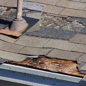 Roof damage with missing roofing shingles